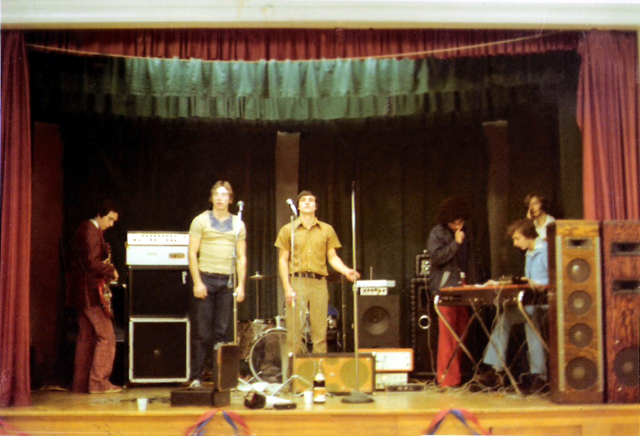The band Parousia, November 6, 1976 with roadie John Sullivan (second from the left).