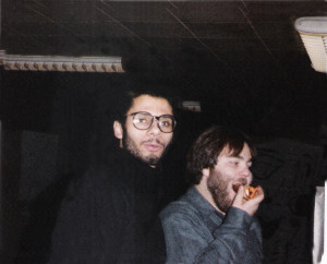 Robert S.Lowden & Mike Zernheld (eating) mingling with the crowd Dec 1984
