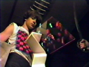 Death's sword is drawn, fearing he may lose this game.  'Keep Running' video  - Aug 1984