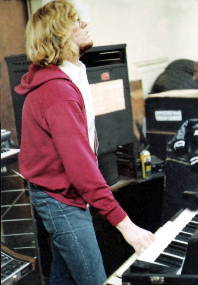 Eric Scheda surrounded by equipment including his Hammond Organ with Leslie Speaker, Fender Rhodes & Moog Sonic Six