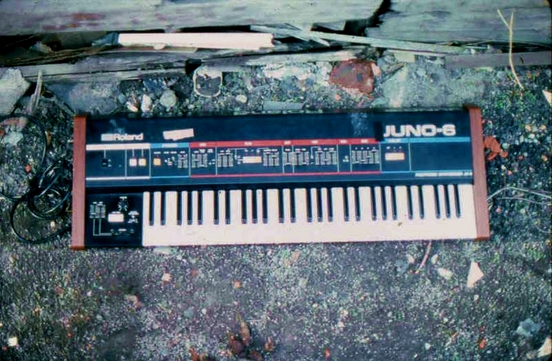 Roland Juno 6 synthesizer against a cracked wall. It must mean something…