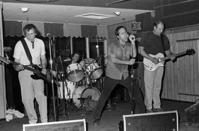 enemies with guitarist Joe Bompczyk (aka Billy Piranha)
